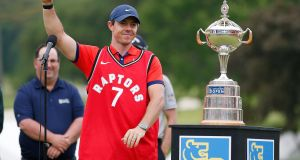 Rory McIlroy wearing a Toronto Raptors vest after winning the Canadian Open in Hamilton, Ontario. Photograph: Michael Reaves/Getty Images