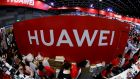 Workers  at the Huawei stand at the Mobile Expo in Bangkok, Thailand. Photograph: Reuters/Jorge Silva