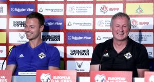 Northern Ireland's  Jonny Evans and manager Michael O'Neill at a press conference in  Minsk, Belarus. Photograph:   Presseye/William Cherry/Inpho