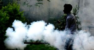 Civic workers carry out fumigation in Bangalore, India. Photograph:  Jagadeesh NV/EPA