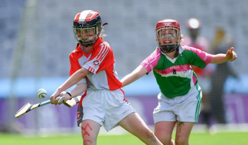 Ciara Kellegher of Divine Word NS, Marley Grange (L) is challenged by Aisling Mac Donncha of Scoil Naithi, Baile an tSaoir, during the Corn Haughey Shield Final at Croke Park. Photograph: Piaras O Midheach/Sportsfile