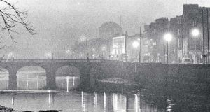 A file image from 1988 showing smog over Capel Street bridge on the river Liffey, with the Four Courts in the background. Photograph: Matt Kavanagh / THE IRISH TIMES