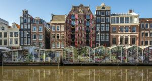 The floating flower market at Singel in Amsterdam. Photograph: iStock