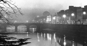 A file photograph from 1988 shows smog over Capel Street bridge in Dublin, with the Four Courts in the background. Photograph: Matt Kavanagh