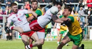 Tyrone's Mattie Donnelly and Donegal's Hugh McFadden in action during the Ulster semi-final at Kingspan Breffni Park.  Photograph: Evan Logan/Inpho