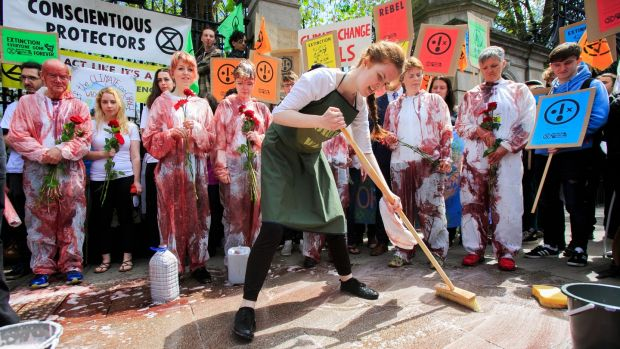Members of Extinction Rebellion Ireland playing characters of characters of Innocents, Politicians and Green-washers during a Blood on our children protest by Extinction Rebellion. Photograph: Gareth Chaney/Collins