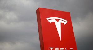 Tesla is increasing output at its US factory, launching production in China, overhauling its US retail and service operations and developing new models. Photograph: Tyrone Siu/Reuters