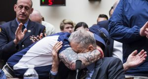 FealGood Foundation co-founder John Feal hugs former Daily Show Host Jon Stewart during a House Judiciary Committee hearing on reauthorization of the September 11th Victim Compensation Fund on Capitol Hill on Tuesday in Washington, DC. Photograph: Getty Images
