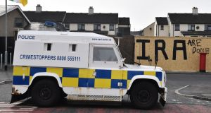 A Police van is parked near graffiti which says 'IRA are done' after journalist Lyra McKee was shot dead last night in Derry in April. Photograph: Charles McQuillan/Getty Images.