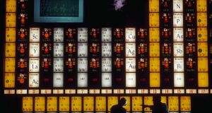 Two scientists use a massive, illuminated periodic table of elements as they discuss the element holmium in the Lawrence Hall of Science at the University of California, Berkeley. Photograph:  Ted Streshinsky/Corbis via Getty Images