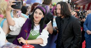 Keanu Reeves poses for a photograph with a fan at the premiere of Toy Story 4 in Los Angeles, California. Photograph: Kevin Winter/Getty Images