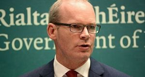 Tánaiste Simon Coveney  is one of two Ministers who have been given approval to draft the general scheme of a Bill to amend the Constitution to allow the Irish diaspora a vote. File photograph: The Irish Times