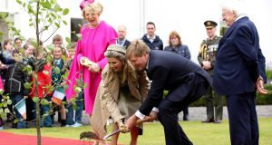 The Netherlands' King Willem-Alexander   and Queen Máxima take part in a tree-planting ceremony, watched by President Michael D Higgins  and his wife Sabina , after arriving at Áras an Uachtaráin. Photograph:  Paul Faith/AFP/Getty Images