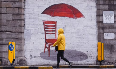 BETTER THAN NOTHING: A woman walks past a mural in the rain on Montpellier Hill, Dublin. Photograph: Fran Veale