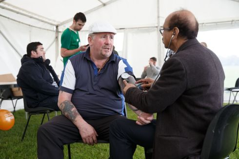 CHANGING ATTITUDES: Hughie Collins has his blood pressure checked by Nurul Amin at Traveller Men's Health Day in the Phoenix Park. Photograph: Fran Veale