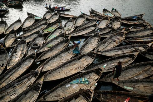 ALL ABOARD: Boats are anchored at the bank of the river Buriganga which are used to carry passengers crossing the river in Dhaka, Bangladesh. Photograph: Mohammad Ponir Hossain/Reuters