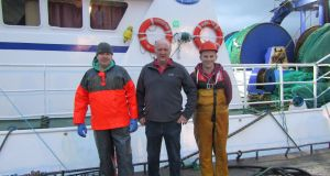 Skipper of the Northern Celt, Adrian McClenaghan (centre), with his son, Mike McClenaghan (right) and crew member Kevin George (left). Photograph: Freya McClements