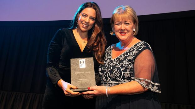 Brenda Dooley, Awards Head Judge, presents the HR Manager of the Year award to Sinead O'Toole, Dalata Hotel Group.