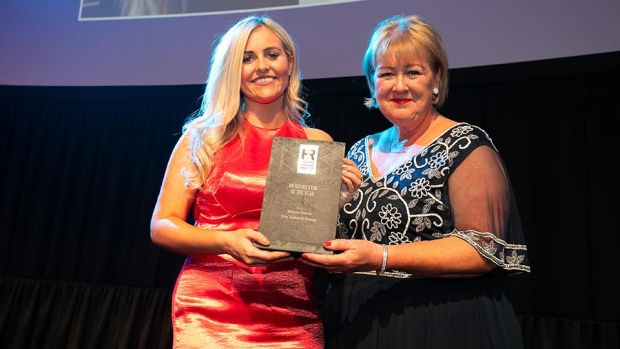 Brenda Dooley, Awards Head Judge, presents the HR Rising Star of the Year award to Marcie Green, The Taxback Group.