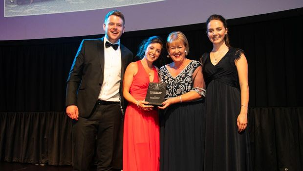 Brenda Dooley, Awards Head Judge, presents the Best Recruitment Agency & HR Team Partnership award to Tom Deane, Kate McGuinness & Emily Jones, Sigmar Recruitment.