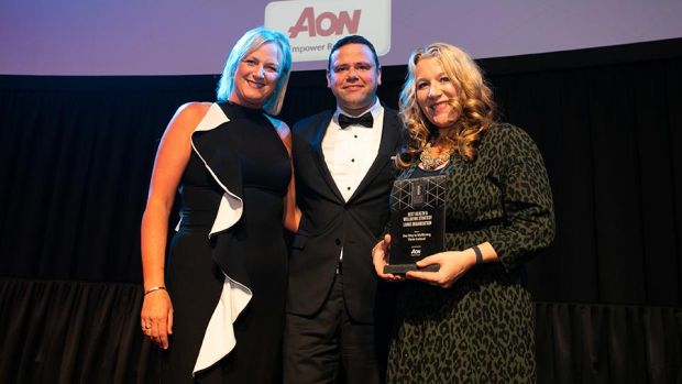 Gary Fearon, Health & Risk Lead, Aon, presents the Best Health & Wellbeing Strategy – Large Organisation award to Jill Johnston & Una Rorke, Three Ireland.