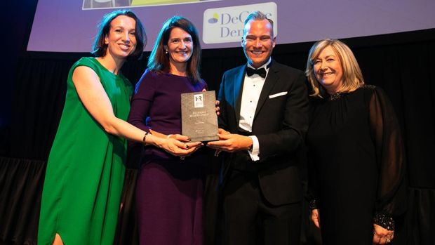 David Casey, Wellness and Health Promotion Manager, DeCare Dental, presents the Best Health & Wellbeing Strategy award to Isobel Tynan, Sarah Downing & Pauleen Swift, Goodbody.