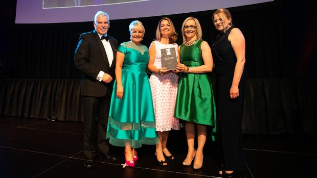 Claire O'Reilly, Awards Judge, presents the Most Effective Employee Engagement Strategy award to the DPD Ireland team.