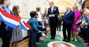 King Willem-Alexander of the Netherlands (centre) meets children as he is welcomed by President Michael Higgins (second right) and his wife Sabina (right) in Dublin on Wednesday. Photograph: Patrick Van Latwijk/AFP/Getty Images