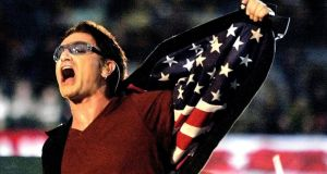 'There is a massive patriotic messaging around sports events': U2 lead singer Bono shows the stars and stripes of the US flag during the 2002 Super Bowl halftime show. Win Mcnamee/Reuters