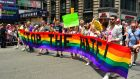 Marchers in the Pride parade in New York City calling for an end to  hatred directed at the gay community