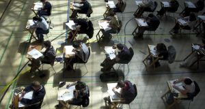 Junior Cert students in Dublin exam hall. many had a 'very challenging' home economics exam. Photograph: Eric Luke