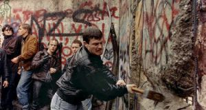 Breaking down the   Berlin Wall. Its fall  initiated a major transformation in the wider European economy whose effects played out over the subsequent 25 years.  Photograph:   David Brauchli/Reuters