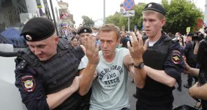 Policemen detain Russian opposition leader Alexei Navalny during a rally in support of investigative journalist Ivan Golunov, who was detained by police, accused of drug offences and later freed, in Moscow on Wednesday. Photograph: Maxim Shemetov/Reuters
