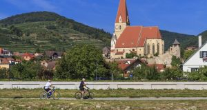 A bicycle lane  runs along the Danube river in the Wachau Valley. Photograph: iStock/Getty Images