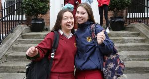 Anna Frizelle from Sutton and Libby Behan from Sandymount, students of Loreto on the Green in Dublin 2, following the Leaving Cert English Paper 1 exam. Photograph: Gareth Chaney Collins