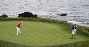Justin Rose walks in a putt for a birdie on the seventh hole during the first round of the 119th US Open Championship at the Pebble Beach Golf Links in Pebble Beach, California. Photo: Erik S. Lesser/EPA