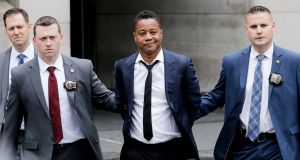 Actor Cuba Gooding Jr is escorted handcuffed by NYPD officers as he exits the New York City Police Department's  Special Victims Division (SVU) in Harlem, New York. Photograph: Eduardo Munoz/Reuters