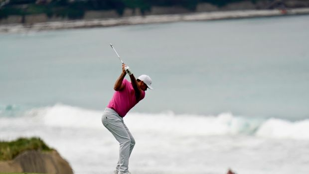 Jason Day plays his approach to the 10th during the first round. Photo: David J. Phillip/AP Photo
