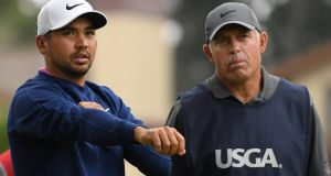 Jason Day and his caddie, Steve Williams, talk on the second hole during the first round of the 2019 US Open at Pebble Beach Golf Links. Photo: Harry How/Getty Images