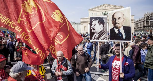 The faces of Stalin and Lenin on banners during May 1st celebratiosn in Moscow. Photograph:  Celestino Arce/NurPhoto/Getty Images