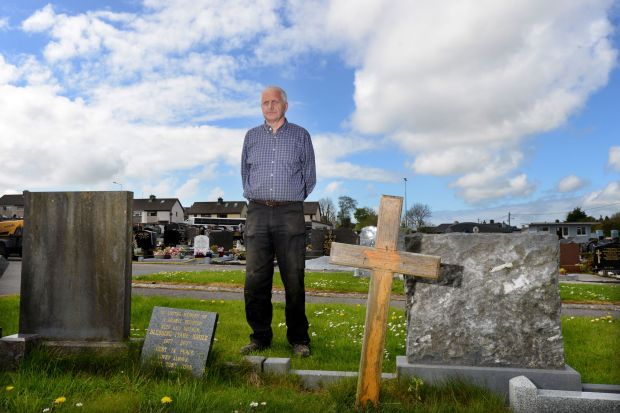 Brian Sclanlon, caretaker of Sligo cemetery, at the unmarked grave of Peter Bergmann. Photograph: Alan Betson