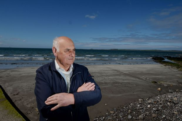 Arthur Kinsella at the spot on Rosses Point beach where he and his son Brian found Peter Bergmann's body in 2009. Photograph: Alan Betson