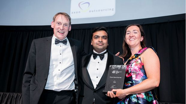 Rohit Garg, Managing Partner, Axon Outsourcing, presents the Finance Team of the Year award to Mark O'Connor & Rose O'Sullivan, Fexco.