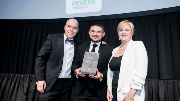 Luke Halpin, on behalf of Relate Software Group, presents the Medium Practice of the Year award to David O'Reilly & Sinead Doherty, Fenero.