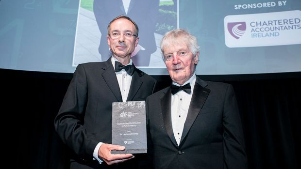 Barry Dempsey, Chief Executive, Chartered Accountants Ireland presents the Outstanding Contribution to Accountancy award to Dr. Laurence Crowley.