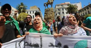 Protesting students demand the removal of the ruling elite in Algiers. Photograph: Ramzi Boudina/Reuters