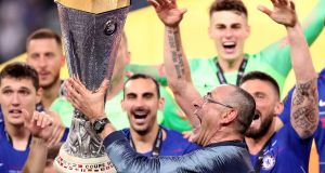 Chelsea manager Maurizio Sarri celebrates with his players on receiving the Uefa Europa League trophy in May, having defeated Arsenal 4-1 in the final. Juventus shares dropped on Friday amid reports that it has agreed a compensation deal with Chelsea to hire Sarri.  Photograph:  Adam Davy/PA Wire.
