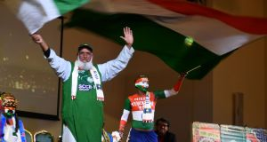 Pakistan and Indian cricket supporters wave flags at a super-fan event in Manchester on Friday ahead of the India v Pakistan World Cup cricket match. Photograph: Dibyangshu Sarkar/AFP