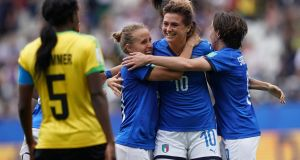 Italy striker  Cristiana Girelli  is congratulated by team-mates after completing her hat-trick in the Women's World Cup game against Jamaica at the  Auguste-Delaune Stadium in Reims. Photograph: Lionel Bonaventure/AFP/Getty Images