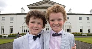 FOLLOW SUIT: Luke (7) and Michael O'Dwyer (8) at a garden party at Áras an Uachtaráin to highlight the issue of gender-based violence. Photograph: Dave Meehan/The Irish Times
